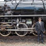 Conductor in front of big train