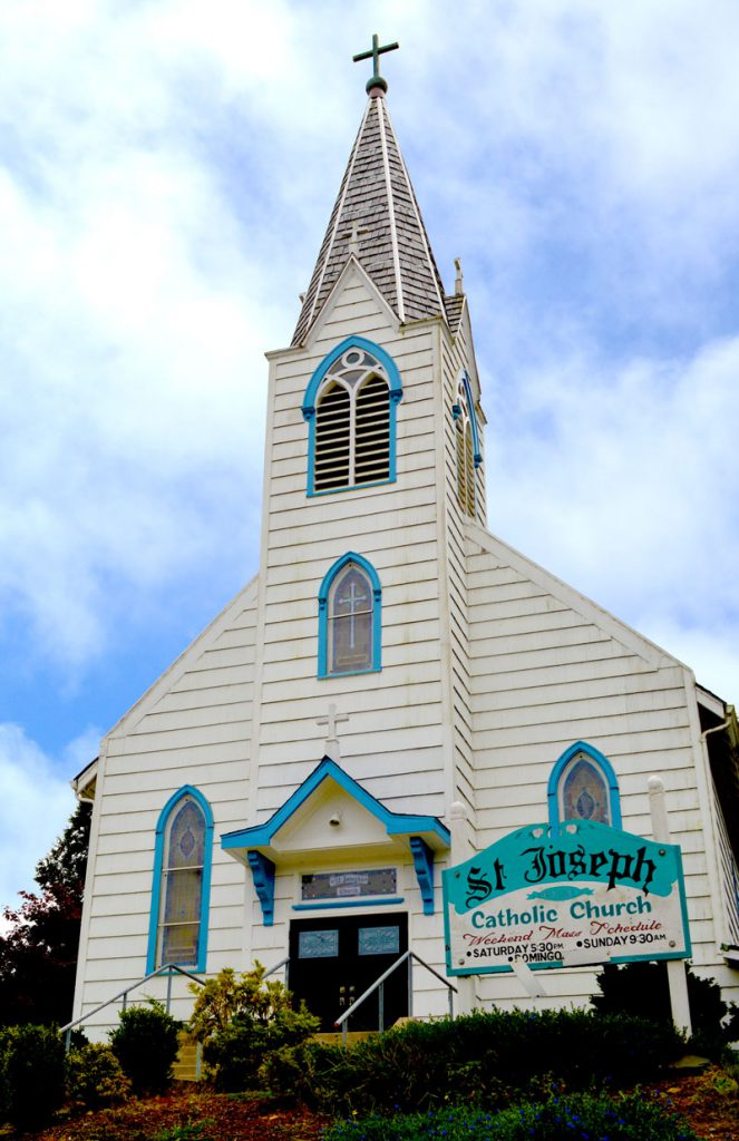 Exterior of white church with steeple