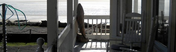 Porch with chairs overlooking the beach
