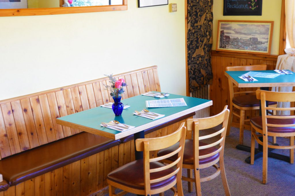 Table and chairs inside the Blue Star Cafe