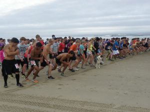 Runners line up on Bayocean Peninsula for the Tillamook Bay Run. (Photo courtesy the Tillamook County Pioneer)