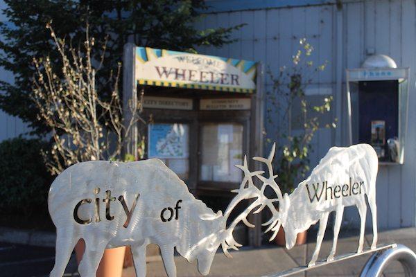 "Metal elk sculptures with ""City of Wheeler"" engraved"