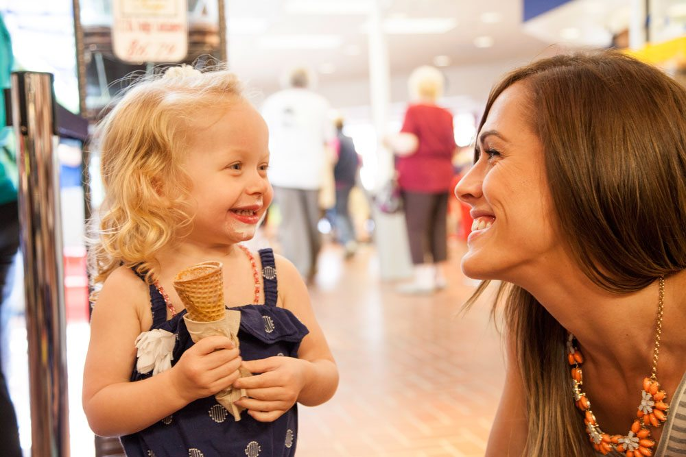 Girl eating Tillamook Ice Cream at Tillamook Cheese Factory