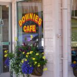 Exterior of Downie's Cafe with flower boxes under the windows