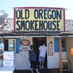 Old Oregon Smokehouse sign and line of customers out the door