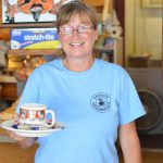 Woman holding teacup at Parkside Cafe