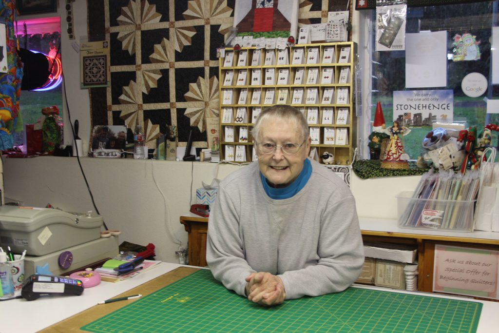 Quilt expert behind the counter in Cloverdale shop