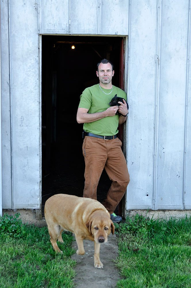 Josh-Blackburn,-piglet-and-Bruiser-the-dog