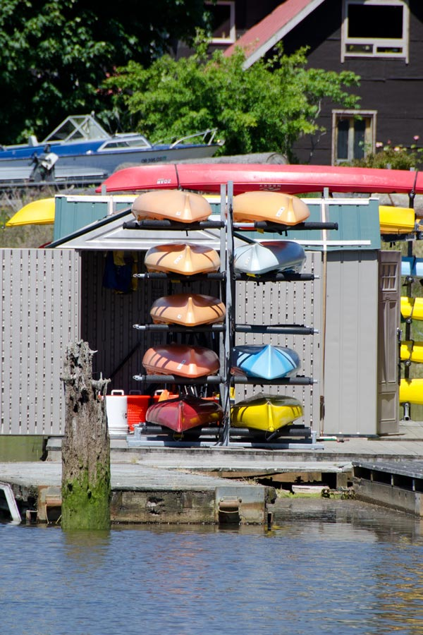 Kayaks stacked by the dock