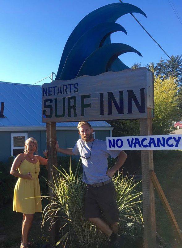 Skyler Veek and Nick Petersen in front of Netarts Surf Inn