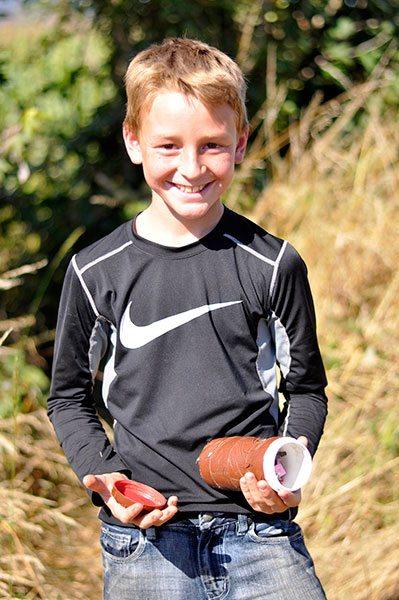 Zeyon Hurliman holds a cache