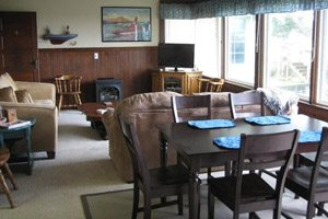 Living room and dining room setup at Anchors Away