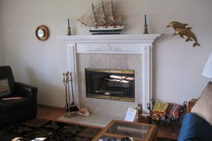 Living room with fireplace and model ship on the mantelpiece