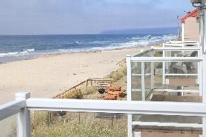 Balcony view overlooking beach