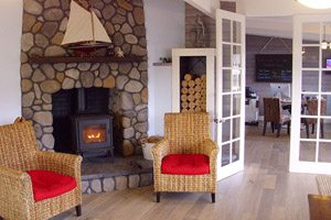 Sitting area with fireplace at Harborview Inn & RV Park