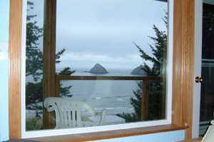 View through a window of the beach and rocks