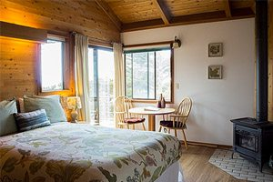 Bedroom with windows and wood stove