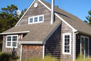 Two-story house with wooden shingles