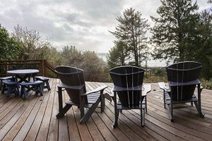 Lounge chairs on porch with tall pine trees in distance