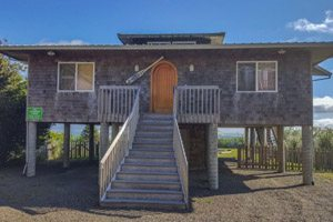 Small rental beach house with tall stairs to front door