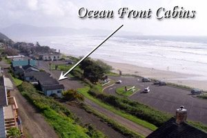 Big-picture view of beach and oceanfront cabins from above