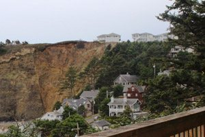 Houses on the side of a steep hill near the ocean