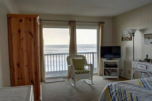 Bedroom with television and rocking chair, window overlooked the ocean
