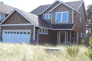 Vacation Rental home with grassy yard
