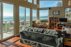 Living room with lots of windows overlooking beach
