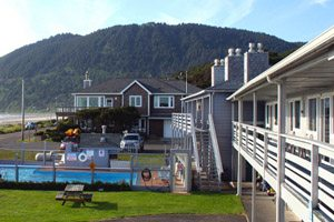 Motel buildings in front of a big hill off the beach