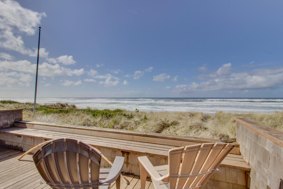 Deck with wooden chairs overlooking the beach