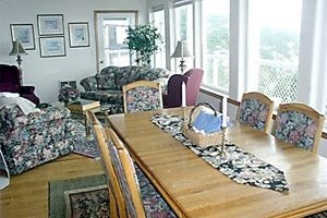 Floral-upholstered living room and dining area