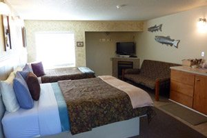 Bedroom interior with fish sculptures on the wall