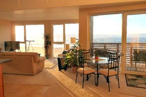 Living room interior with beach view windows