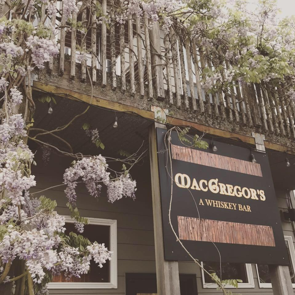 McGregor's - A Whiskey Bar sign on porch with wisteria