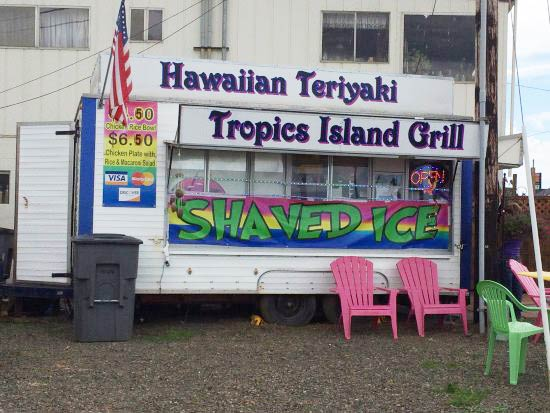 Food cart with signs for Hawaiian teriyaki and shaved ice