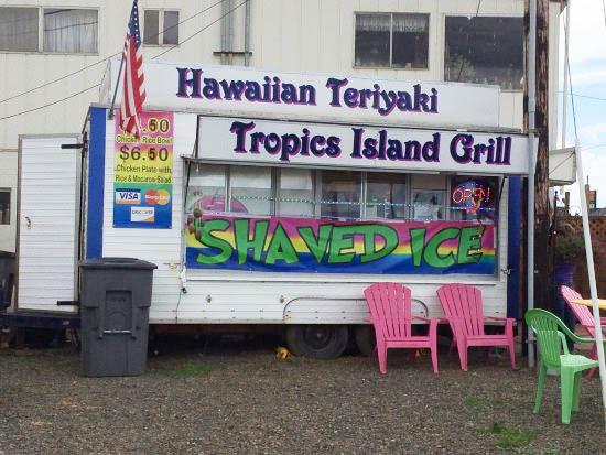 Food cart with signs for Hawaiian teriyaki and shaved ice