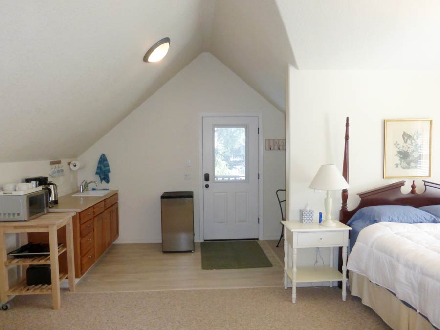 Bedroom and mini kitchen at Nedonna Beach Studio Retreat