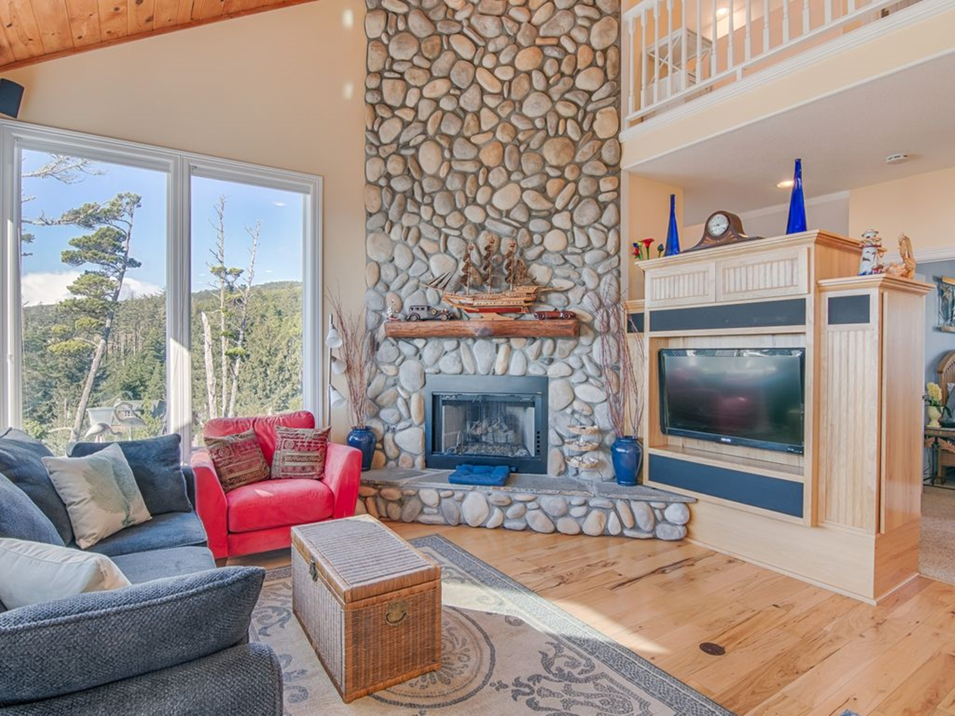 Modern living room with stone facade fireplace
