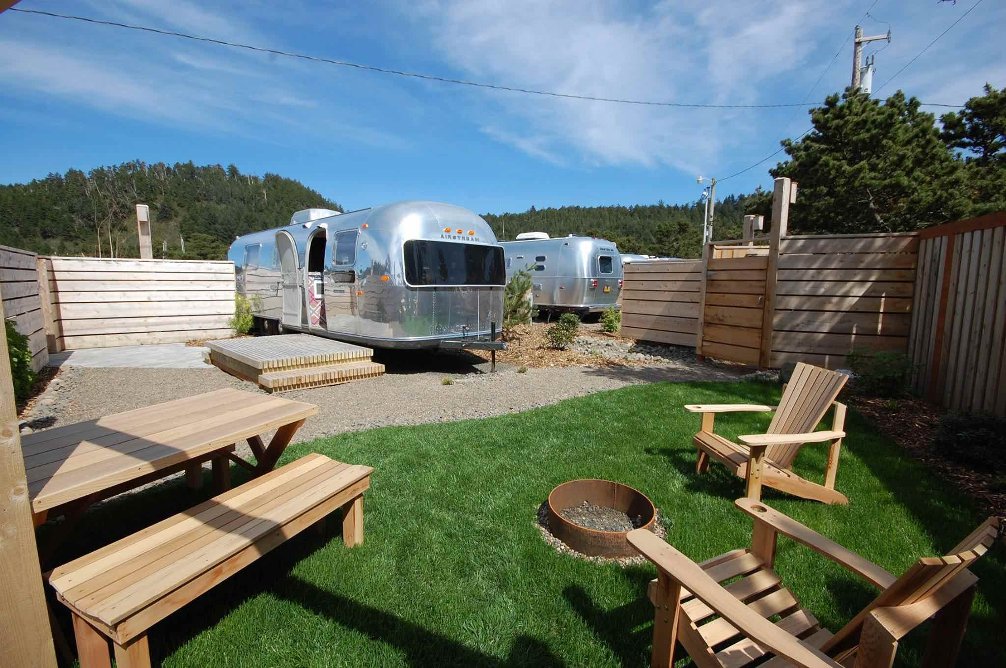 Outdoor area with trailers, picnic table, lounge chairs