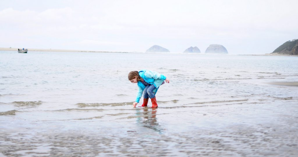 Child playing in the ocean at Netarts Bay