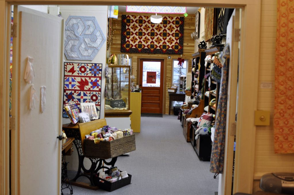 Colorful textiles made by local artisans are for sale at the Latimer Quilt and Textile Center