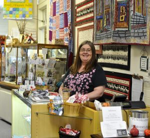 Latimer Quilt and Textile Center Associate Manager Kim Schauss is also a museum member. She takes classes at the center and welcomes guests cheerfully with both a cup of tea and talk