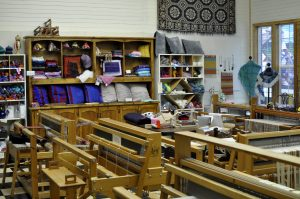 Weavers gather weekly to work the heirloom looms at the Latimer Quilt and Textile Center. JPG