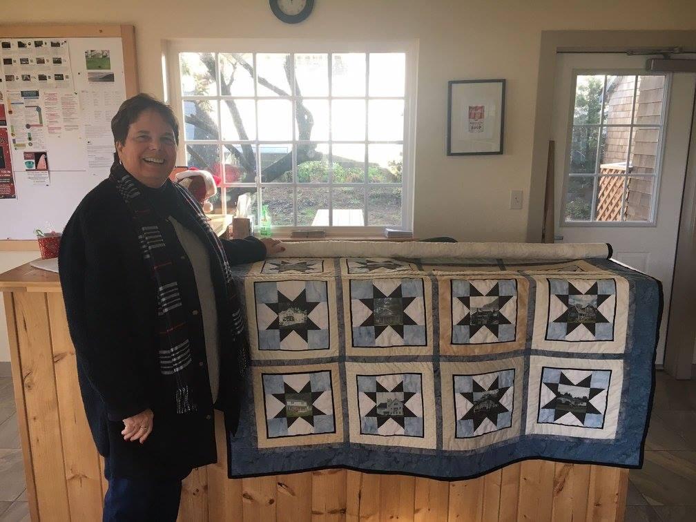The Manzanita Womens Club donated this handmade quilt to the Manzanita Visitors Center Photo by Dan Haag